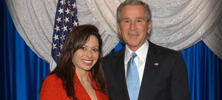 Teresa Madrigal of AGMS with President Bush